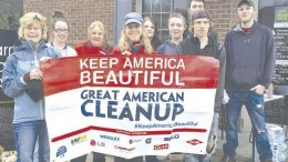 """A partial group of volunteers gather after the clean-up holding a banner that says """"Keep America Beautiful"""" which is the motto of The Great American Cleanup of Pennsylvania. (Submitted photo)"""