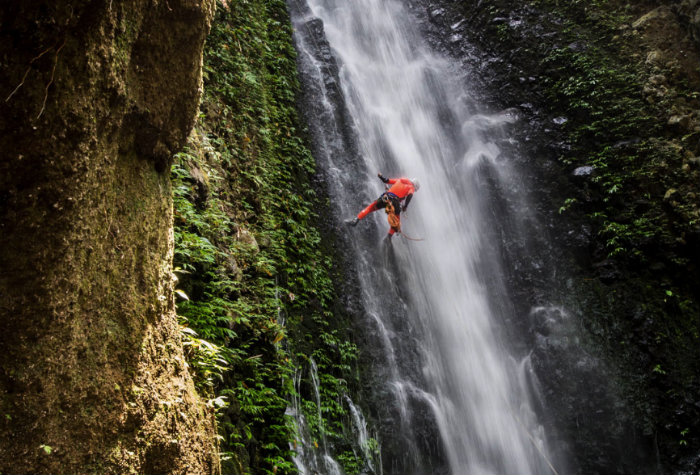Canyoning down waterfall