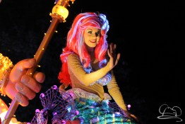 The Little Mermaid swims with Scuttle and King Triton in Disneyland's Paint the Night Parade.