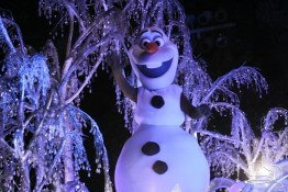 Olaf waves hello in Disneyland's Paint the Night Parade!