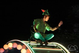 Peter Pan rides high on a magical drum in Paint the Night Parade