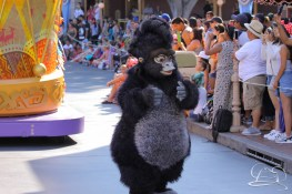 Terk dances away in front of The Lion King unit in Mickey's Soundsational Parade.