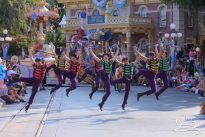 Chimney Sweeps kick their knees up in Mickey's Soundsational Parade as Mary Poppins and Bert follow along behind.