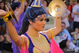 One of Aladdin's dancers proclaims the arrival of Prince Ali in Mickey's Soundsational Parade.