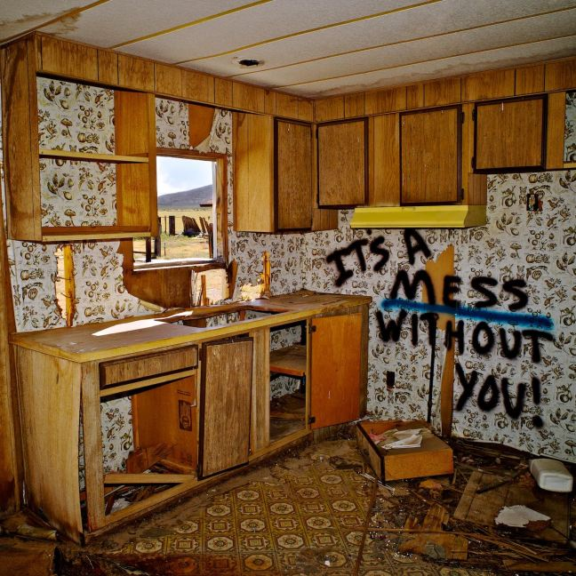 """First printed: 2014I had been photographing the abandoned trailers at this site for four years before capturing this image. The same room appears in an earlier photograph """"Desert Kitchen - Cinco, CA - 2010"""" before the sink was pried out and some unknown person or persons were moved to add this memorable inscription to the scene. As a documentary photographer, I can only bear witness to the aftermath of such events, wondering like you, who may have spray-painted the note, in what circumstance, and for what intended audience. Whatever the author's intention, this image has caught the imagination of a wide range of people on a personal level, leading to rampant, engaging speculation as to the full story. The large-size print edition is on its way to selling out, but a smaller-size edition is available as well.Photo LA – The REEF - Los Angeles, CA – 2017Finalist - FOCUS Photo – 2016Office Hours – The Main Museum – Los Angeles, CA - 2016Museum Tour (Solo Show) - Venice Institute of Contemporary Art/Gypsy Trails Gallery - Torrance Art Museum - 2015Boom: a Journal of California - Framing the Desert - Summer 2015West Hollywood Lifestyle Magazine - Premiere Issue - Winter 2014The Life of Things - SCA Project Gallery - Pomona, CA - 2014KCET Artbound: High & Dry - A Collaboration Surveying the American Desert - May 21, 2014Solo Exhibition - Los Angeles Art Association/Gallery 825 - 2014"""