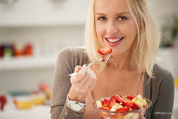 Woman Eating a Fruit Salad