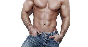 Sexy muscular man body, posing at white wall
