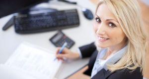 Beautiful businesswoman doing finances