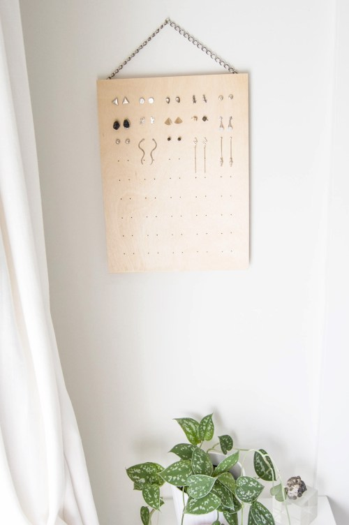 Organize your earrings with this DIY stud earring rack
