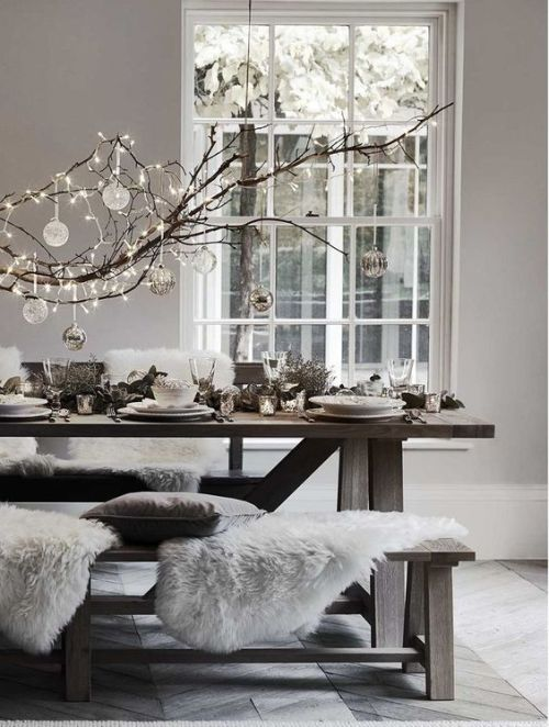 Simple DIY holiday decor ideas using white lights: Bare branch + glass balls + white lights