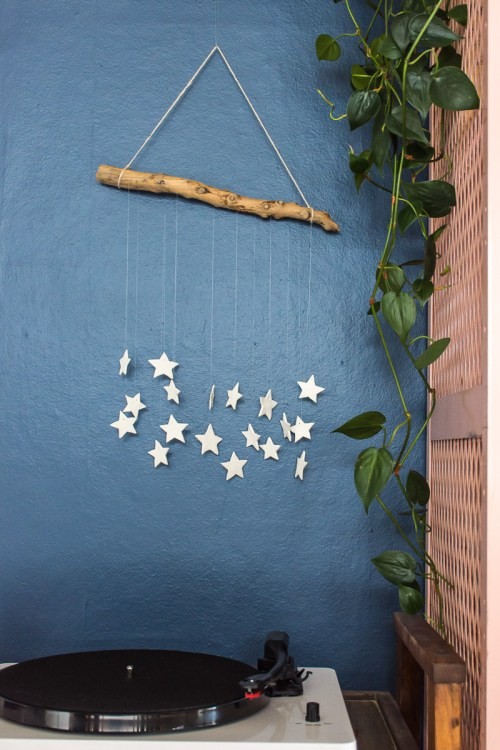 Make this Christmas star wall hanging with air dry clay, string, and a branch