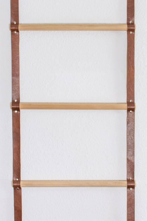 Follow these instructions to make a wood and leather storage ladder