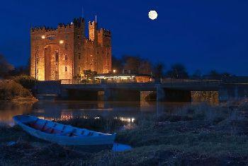 irish castle at night under the moon