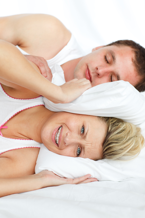 bigstockphoto_Woman_Trying_To_Sleep_With_Man_5894220