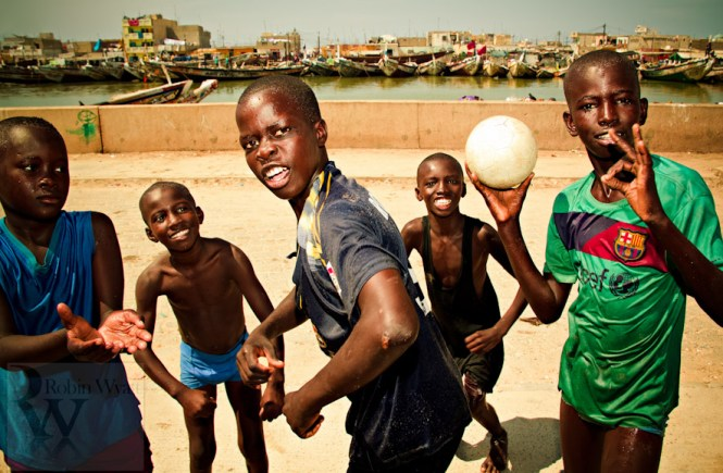 Photo of football kids on the coast of Senegal by Robin Wyatt