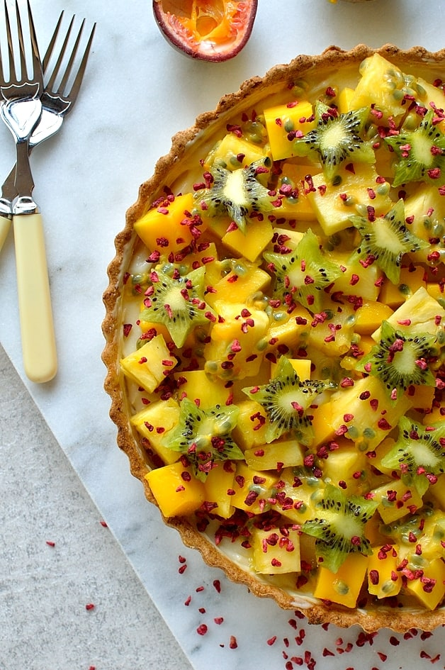 Tropical fruit coconut tart - cripsy coconut pastry shell filled with coconut milk creme patissiere and tropical fruits