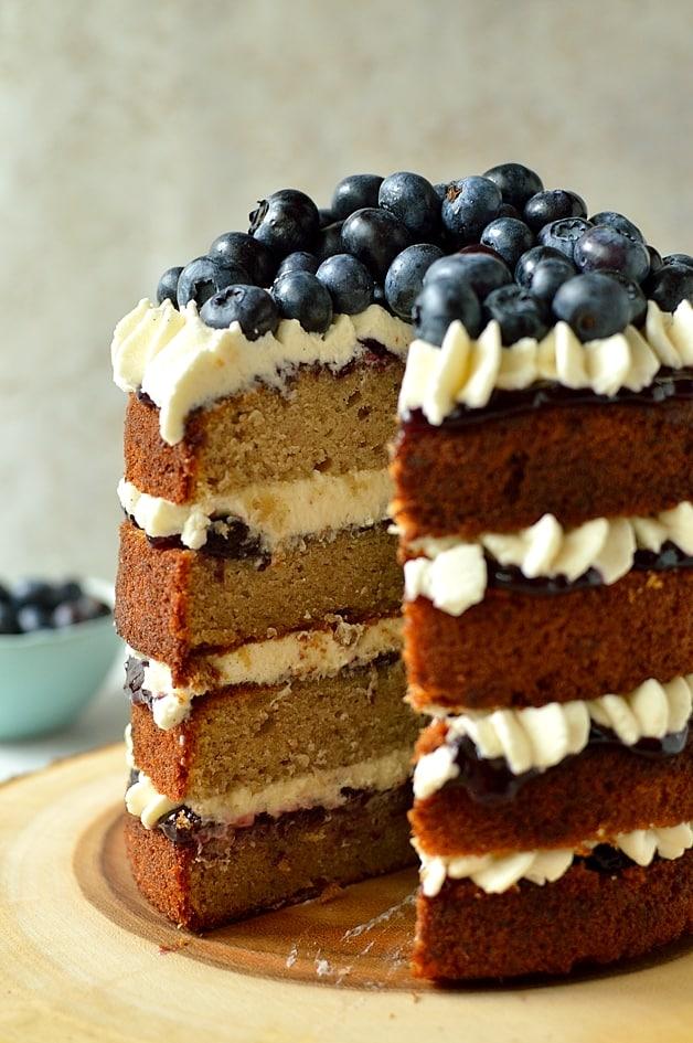 Gluten free blueberry banana buckwheat layer cake with vanilla mascarpone cream frosting