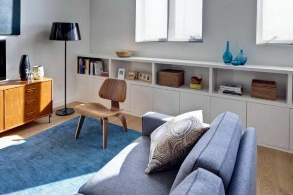 Brown-And-Blue-Living-Room-With-Bookshelves
