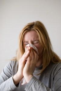 sick woman in an office