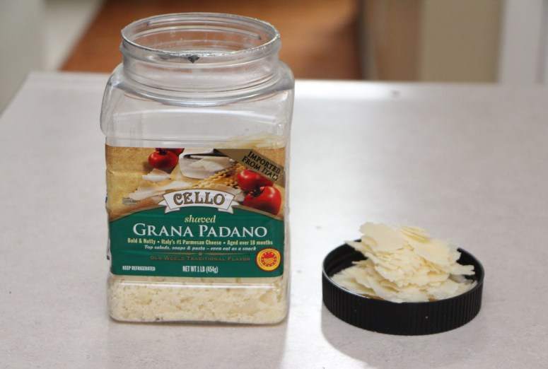 Cheddar Basil Parmesan Toasts with shaved parmesan from Costco