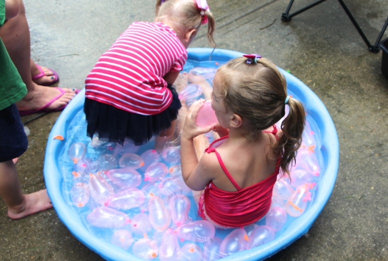 Water activities for toddlers - fill kiddie pool with water balloons!