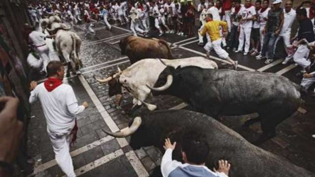 The Running of the Bulls in Pamplona, Spain