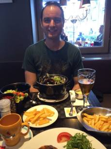 Ian is very pleased with his pot o' mussels in Bruges.