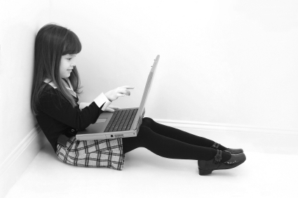 Child using laptop - internet safety