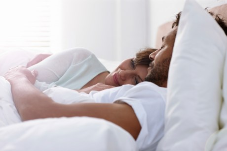 Mature couple sleeping in bed together