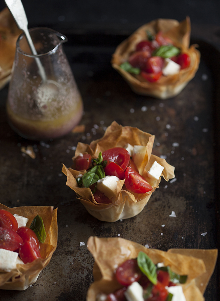 caprese salad in phyllo baskets with an olive tapenade vinaigrette