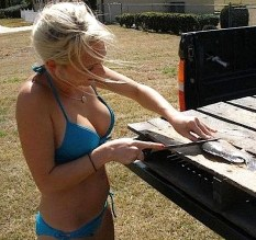 Girl filleting fish