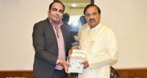 Dr Prem Jagyasi with Dr Mahesh Sharma - Honourable Minister of Culture & Tourism and Civil Aviation of India, discussing and presenting guide books about Medical Tourism and Wellness Tourism. -