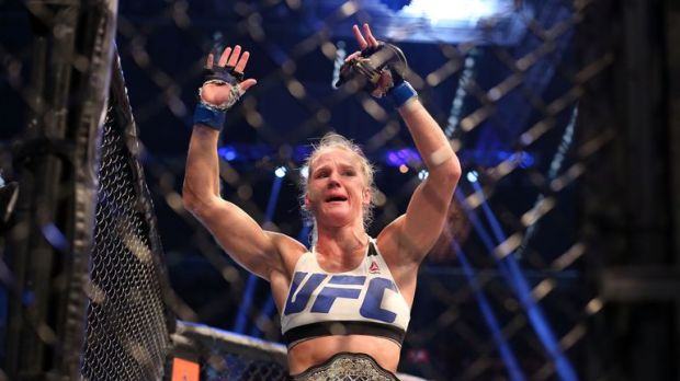 Holm celebrates victory in Melbourne with her new UFC bantamweight title belt