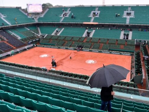 It was a soggy scene at Roland Garros on Monday