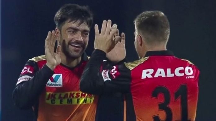 Rashid Khan (L) and David Warner have both played major roles in Sunrisers' charge into the play-offs