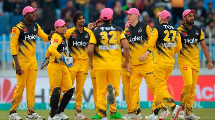Peshawar Zalmi's Rahat Ali (3rd L) celebrates after dismissing Islamabad United's Luke Ronchi