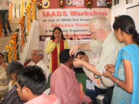 Administering acupuncture detox treatments in India