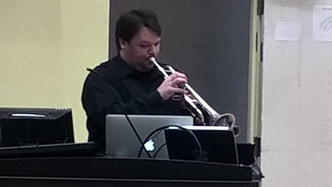 Dr. Adler performs at Mathes Hall on Feb. 29. (Photograph by Dylan Looney)