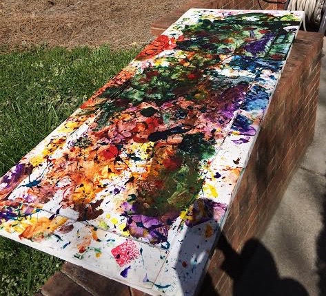 This painted door is just one of the larger pieces that will be on auction at the Little Bucs art exhibit at the Reece Museum from April 18-20. (Photograph By: Jordan Hensley)