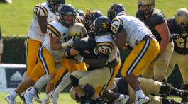 Bucs tackle Wofford player. Photo by Dakota Hamilton.