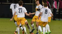 Celebration after Joe Pickering (18) goal against UNCG. Photo by Dakota Hamilton.