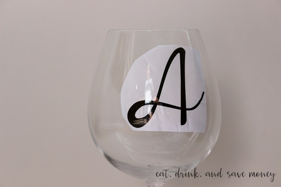 Place printed letters in wine glass to trace for hand painted wine glasses