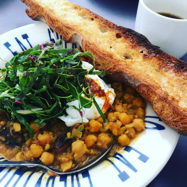 Braised  chickpeas long bread two poachedeggs w harissa andhellip