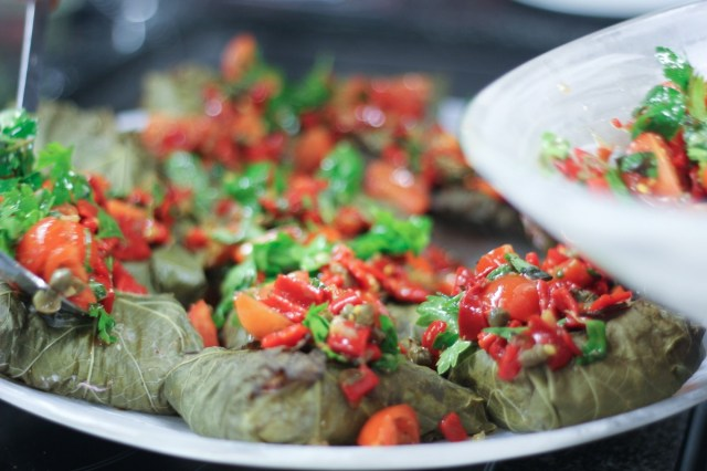 Halibut wrapped in vine leaves, grilled with dukkah and lemon and served with piccolo pepper, cherry tomato, caper, basil and chopped herb salsa