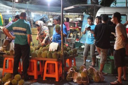 Durian o'clock at the market in Brunei - it is hugely popular here, and just in season