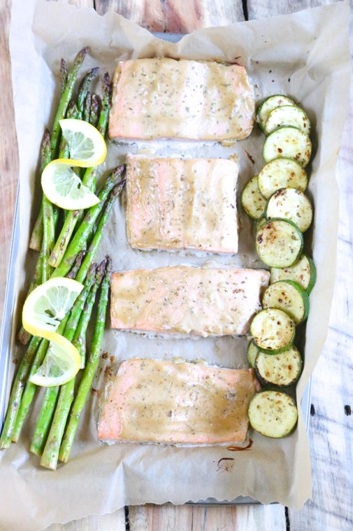 Honey Mustard Glazed Salmon with Marinated Veggies | Sweet and tangy glazed salmon pairs perfectly with sautéed asparagus and zucchini which has been marinated in lemon oregano marinade. | eatsomethingdelicious.com