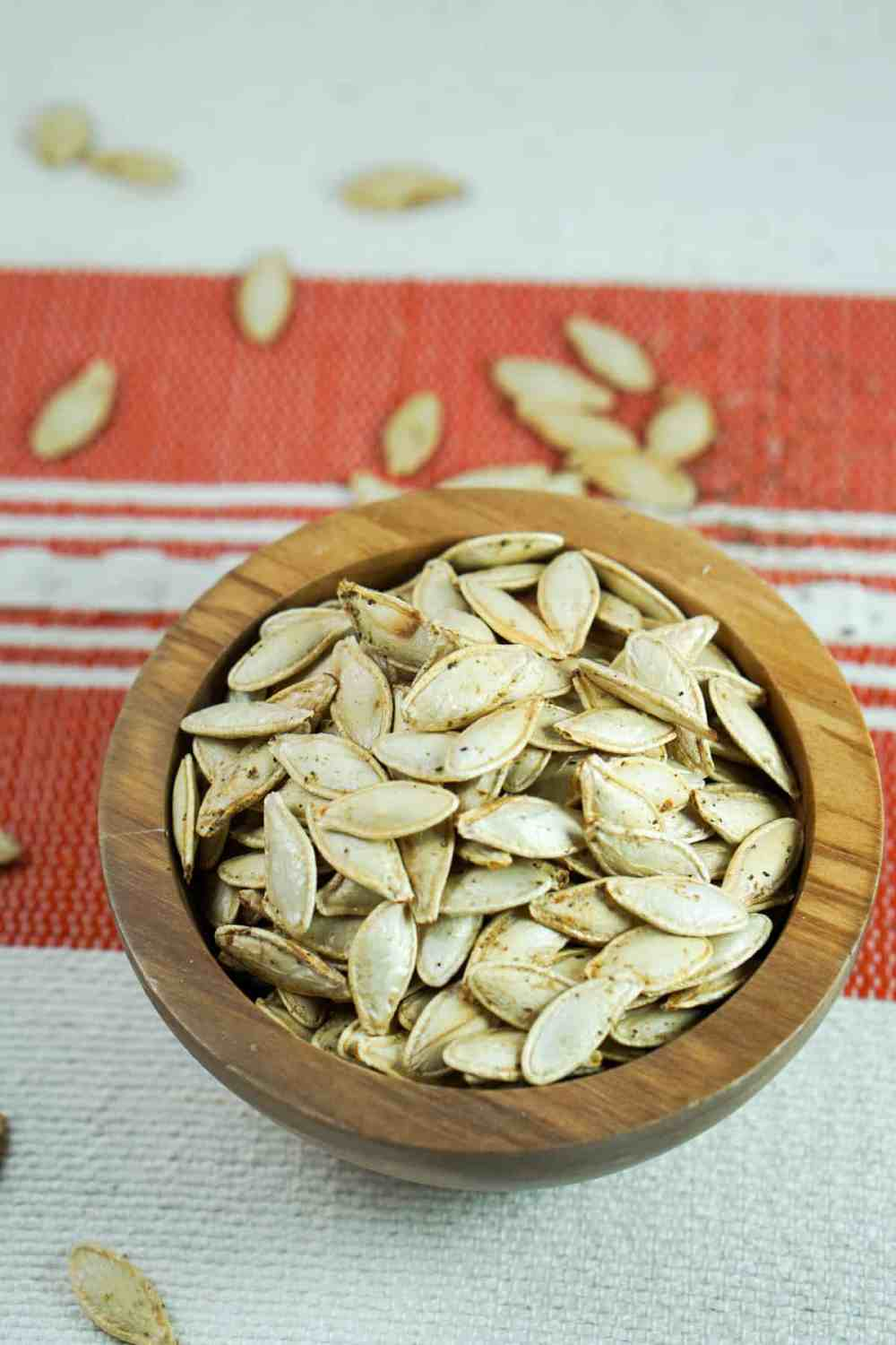 This toasted salted pumpkin seeds recipe is ridiculously easy. Wash & strain, season, dry and roast for deliciously crisp seeds. Then crunch away and enjoy!
