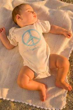 organic cotton onesie with peace logo