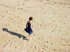 English: Girl walking in a beach. Porto Covo, ...