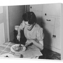 Canvas Print Of Young Woman In A Kitchen Eating A Plate Of Food